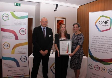 Michelle receives her certificate from Louise Morritt, Chief Executive and Ray Snowdon at One Awards