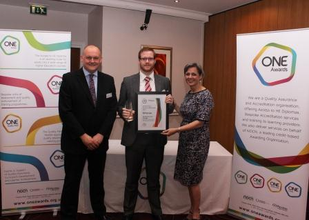 Ian receives his award from Louise Morritt, Chief Executive and Ray Snowdon, Chair at One Awards